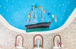 Landscapes and architectures of Brittany. Portivy, France - August 9, 2017:  A model of an ancient sailing ship hanging from the ceiling of the the Lotivy chapel Royalty Free Stock Photo