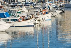 Portixol marina moored boats. PALMA DE MALLORCA, SPAIN - JANUARY 4, 2018: Portixol marina moored boats in afternoon sunshine on January 4, 2018 in Palma de Stock Image