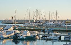 Portixol marina moored boats. PALMA DE MALLORCA, SPAIN - JANUARY 4, 2018: Portixol marina moored boats in afternoon sunshine on January 4, 2018 in Palma de Royalty Free Stock Images