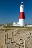 Portland Bill Lighthouse. Portland Bill is a narrow promontory (or bill) of Portland stone, which forms the most southerly part of Isle of Portland, and the Stock Image