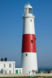 Portland Bill Lighthouse. Portland Bill is a narrow promontory (or bill) of Portland stone, which forms the most southerly part of Isle of Portland, and the Royalty Free Stock Photos