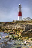 Portland Bill lighthouse. Dorset, England, with rocks at low tide, HDR Stock Photos