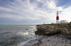 Portland Bill Lighthouse. The lighthouse and oblesik at Portland Bill on the Jurassic Coast near Weymouth in Dorset Stock Images