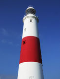 Portland Bill Lighthouse. Looking up at Portland Bill Lighthouse, Dorset, England, with blue sky behind Stock Photography