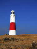 Portland Bill Lighthouse. Looking up at Portland Bill Lighthouse, Dorset, England, with blue sky behind Royalty Free Stock Photos