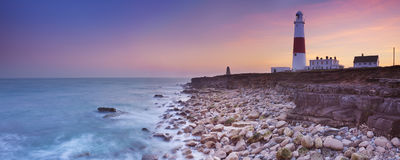 The Portland Bill Lighthouse in Dorset, England at sunset. The Portland Bill Lighthouse on the Isle of Portland in Dorset, England at sunset Royalty Free Stock Image