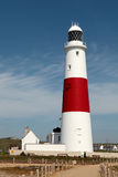 Portland Bill Lighthouse in Dorset. Rear view of the large white and red lighthouse on Portland rocks in Weymouth Stock Photo