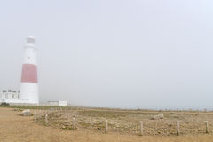 Portland Bill lighthouse in mist. On Dorset coast Stock Images