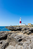 Portland Bill Lighthouse on Portland rocks in sunny summer day Royalty Free Stock Photos