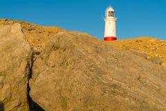 Portland Bill Lighthouse, Jurassic Coast, Dorset, UK. Portland Bill Lighthouse seen from the rocks near Pulpit Rock, Jurassic Coast, Dorset, UK, Jurassic Coast Stock Photography