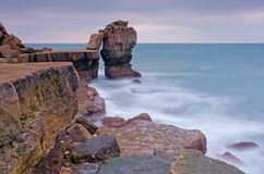 Portland Bill, roche de pupitre Photographie stock libre de droits