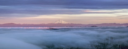 Portland City Covered in Fog with Mt Hood Panorama. Portland Oregon Downtown Covered in Fog at Sunset with Mount Hood Panorama Royalty Free Stock Image