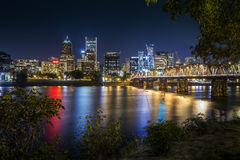 Portland city skyline during early night. With Hawthorne bridge crossing the Willamette River Royalty Free Stock Image