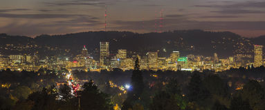 Portland City Skyline Lights Up at Night. Portland Oregon Downtown City Skyline Lights Up at Dusk Panorama Royalty Free Stock Photos