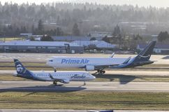Portland, OR - December 2017: Prime Air Boeing 767 operated by Atlas Air taxiing to the runway as a SkyWest Embraer ERJ-175 slows royalty free stock images