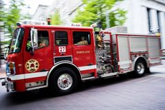 Portland Fire Department to the Rescue. Portland Fire Truck racing down on May Day protest May, 1st. 2017 5/01/17, downtown Portland, OR stock image
