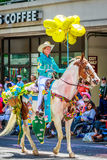 Portland Grand Floral Parade 2015. Portland, Oregon, USA - June 6, 2015: Maggy Constantino and Cloud in the Grand Floral Parade during Portland Rose Festival Stock Photography