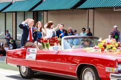 Portland Grand Floral Parade 2014. Portland, Oregon, USA - JUNE 7, 2014: Rose Festival President, Todd Johnston in Grand floral parade through Portland downtown Stock Image