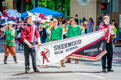 Portland Grand Floral Parade 2015. Portland, Oregon, USA - June 6, 2015: Sherwood High School Marching Band in the Grand Floral Parade during Portland Rose stock photography