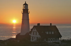Portland Headlight Lighthouse at Sunrise, Maine. Portland Head Light, Fort Williams Park, Portland, Maine is one of the oldest lighthouses Stock Image