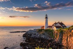 Portland Head Lighthouse at sunrise. Portland Head Lighthouse in Cape Elizabeth, Maine, USA. Portland Headlight Completed in 1791, Portland Headlight is one of royalty free stock photo