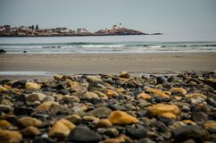 Portland Head Lighthouse Maine view from rocky beach Royalty Free Stock Photography