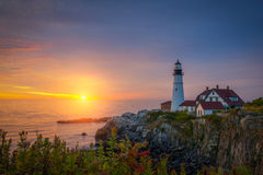 Portland Head Lighthouse at sunrise. Beautiful sunrise over the ocean from Portland Head Light in Maine Royalty Free Stock Images