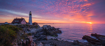Portland Head Lighthouse Sunrise Panorama. Colorful sunrise at Portland Head Lighthouse in Maine Royalty Free Stock Photos