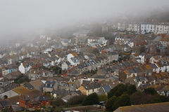 Portland houses in fog, Dorset. Royalty Free Stock Image