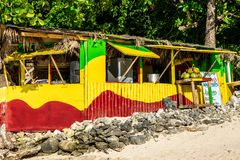 Traditional colorful outdoor vendor bamboo/wood cook shop on Winnifred Beach, Portland, Jamaica stock images