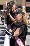 PORTLAND - JUNE 12: ROSE FESTIVAL ANNUAL PARADE. A man & woman playing a flute in a band at a parade rose festival, Portland Oregon Royalty Free Stock Images