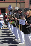 PORTLAND - JUNE 12: ROSE FESTIVAL ANNUAL PARADE. A lady playing a small flute in the lineup a business representing standard TV & appliance company, Rose parade Stock Photography
