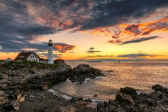 Portland Lighthouse at sunrise, Maine, USA. Portland Head Lighthouse in Cape Elizabeth, Maine, USA. One Of The Most Iconic And Beautiful Lighthouses stock image