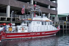 Portland Maine Fire rescue Boat. Portland, Maine. February 17, 2018. The Marine 1 Portland Maine fire boat docked on the water in this new england city stock images