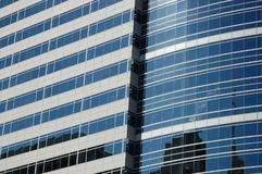 Portland, OR Office Building Reflection. A modern downtown office building in Portland, Oregon reflecting other buildings in its windows Royalty Free Stock Image