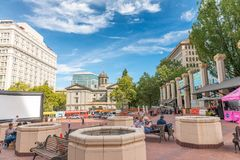 PORTLAND, OREGON - AUGUST 21, 2017: Tourists along city square. Portland attracts 5 million people annually stock images