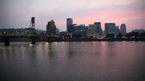 Portland Oregon Downtown City Skyline with Hawthorne Bridge Water Reflection along Willamette River at Colorful Sunset 1080p stock video
