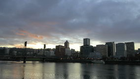 Portland Oregon Downtown City Skyline with Moving Clouds and Sunrays at Sunset Time Lapse 1080p. Portland Oregon Downtown City Skyline with Moving Clouds and stock video footage