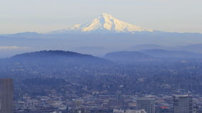 Portland Oregon Downtown Cityscape with Fog and Snow Covered Mount Hood in Winter Season 1080p Stock Photos