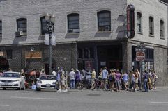Voodoo Doughnuts in Portland, Oregon with long line of customers royalty free stock image