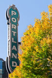 Portland Oregon neon sign with fall. Portland Oregon name logo on a sunny fall day framed by golden, yellow trees Stock Photography
