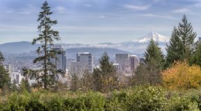 Portland Oregon skyline panorama and Mt. Hood. Portland Oregon panorama skyline, fog and Mt. Hood royalty free stock photo