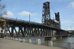 Historic Steel Bridge in Portland, Oregon under a blue sky. This is Portland, Oregon`s historic Steel Bridge spanning the Willamette River Royalty Free Stock Photo