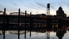 Portland Oregon Scenic View of Downtown City Skyline with Hawthorne Bridge across Willamette River at Blue Hour Panning Stock Photography