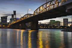Portland Oregon Skyline Under Hawthorne Bridge. Portland Oregon City Skyline Under Hawthorne Bridge by the Bank of Willamette River at Dusk Royalty Free Stock Images
