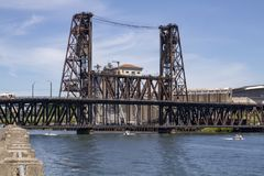 Portland Oregon Summer Boating on Willamette River with Steel Bridge on a sunny day. With small boats below stock images
