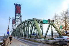 The Hawthorne Bridge on Willamette River in downtown Portland. Portland, Oregon, United States - Dec 24, 2017 : The Hawthorne Bridge on Willamette River in Stock Images