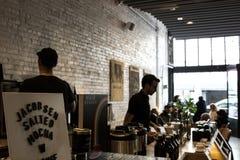 Baristas prepare espresso drinks at Porltand's Stumptown Coffee stock photography