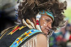Close up of an American Indian at a Pow Wow. Portland, Oregon USA - June 14, 2014: Close up portrait of an American Indian in full dress at a Pacific Northwest royalty free stock image