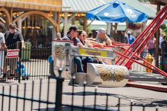 Family on the fast amusement ride royalty free stock photography